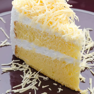 slice of frosted layer cake