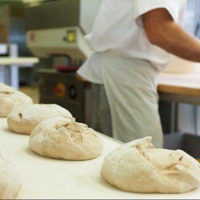 baker baking fresh bread in the bakehouse.